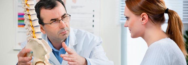Chiropractic Fort Myers FL Chiropractor Educating Patient